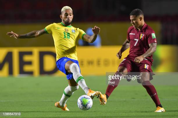 Douglas Luiz of Brazil fights for the ball with Darwin Machis of Venezuela during a match between Brazil and Venezuela as part of South American...