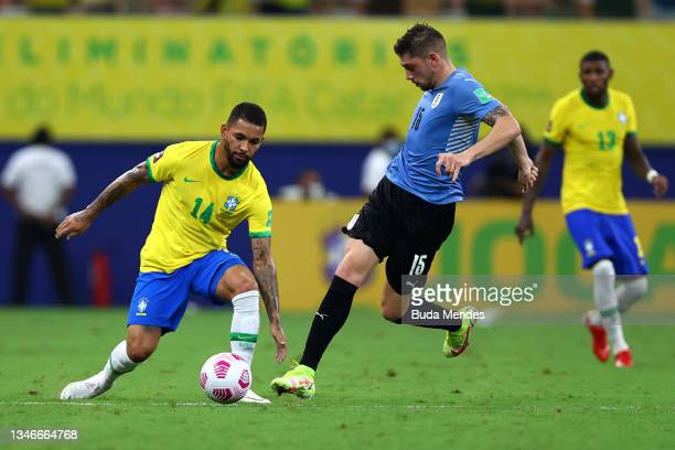 Douglas Luiz of Brazil fights for the ball with Federico Valverde of Uruguay during a match between Brazil and Uruguay as part of South American...