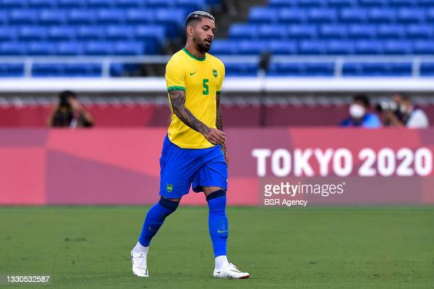 Douglas Luiz of Brazil leaves the pitch after receiving a red card during the Tokyo 2020 Olympic Mens Football Tournament match between Brazil and...