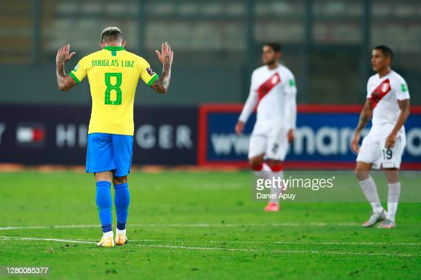 Douglas Luiz of Brazil reacts during a match between Peru and Brazil as part of South American Qualifiers for Qatar 2022 at Estadio Nacional de Lima...