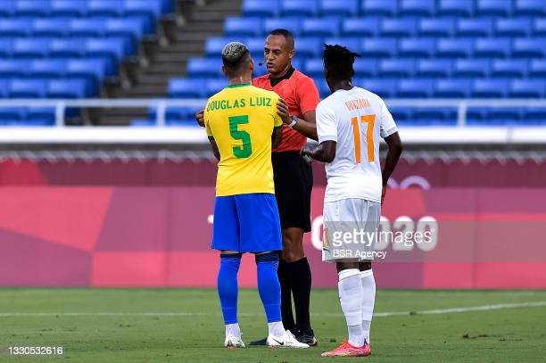 Douglas Luiz of Brazil, Referee Ismail Elfath of USA and Zie Ouattara of Ivory Coast during the Tokyo 2020 Olympic Mens Football Tournament match...