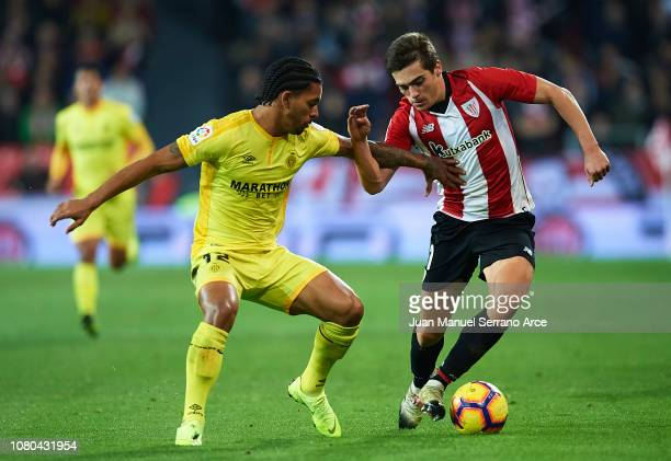 Douglas Luiz of Girona FC competes for the ball with Iñigo Cordoba of Athletic Club during the La Liga match between Athletic Club and Girona FC at...