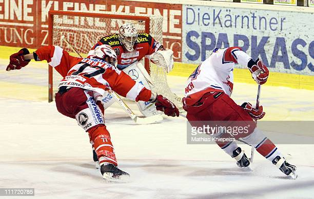 Douglas Lynch of Salzburg moves to the goal against Sean Brown of KAC during the EHL match between EC KAC and Red Bull Salzburg at Stadthalle...