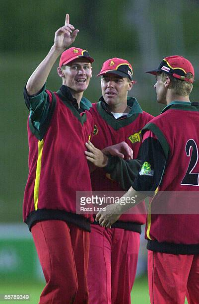 Douglas Marillier is congratulated by his team mates on taking the wicket of Craig McMillan during the first one day cricket international between...