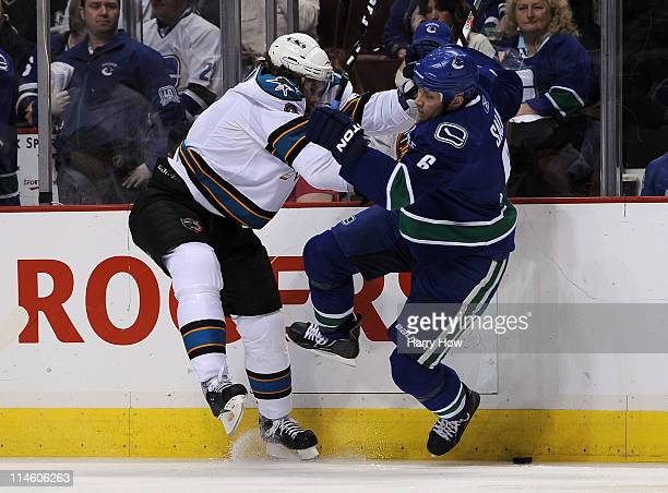 Douglas Murray of the San Jose Sharks checks Sami Salo of the Vancouver Canucks in the first period in Game Five of the Western Conference Finals...