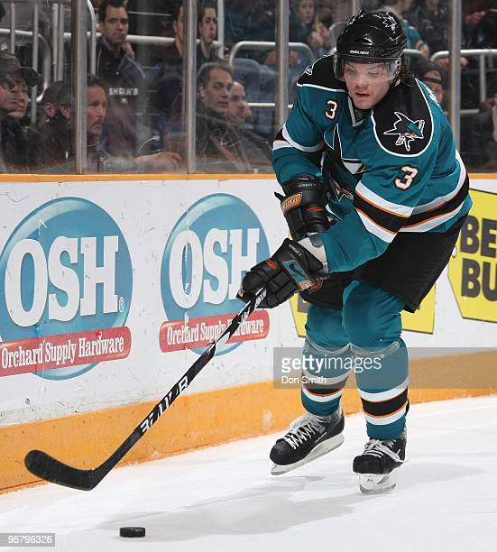 Douglas Murray of the San Jose Sharks handles the puck along the boards during an NHL game against the Detroit Red Wings on January 9, 2010 at HP...