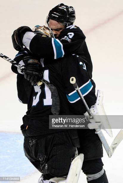 Douglas Murray of the San Jose Sharks hugs goalie Antti Niemi after defeating the Detroit Red Wings 3 to 2 in Game Seven of the Western Conference...