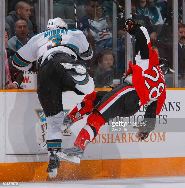 Douglas Murray of the San Jose Sharks makes the huge hit on Randy Lapointe of the Ottawa Senators during a NHL game on March 5 2008 at HP Pavilion at...