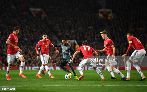 Douglas of Benfica is watched by Manchester United defence during the UEFA Champions League group A match between Manchester United and SL Benfica at...