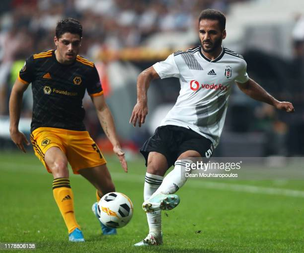Douglas of Besiktas passes the ball under pressure from Pedro Neto of Wolverhampton Wanderers during the UEFA Europa League group K match between...