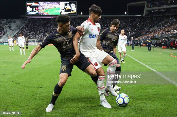 Douglas of Corinthians Lucas Paqueta of Flamengo and Romero of Corinthians in action during the match for the Brasileirao Series A 2018 at Arena...