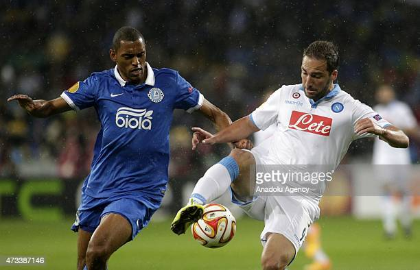 Douglas of Dnipro is in action against Gonzalo Higuain of Napoli during the UEFA Europa League Semi Final second leg match between FC Dnipro...