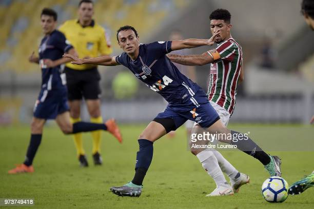 Douglas of Fluminense struggles for the ball with Diego Pituca of Santos during the match between Fluminense and Santos as part of Brasileirao Series...
