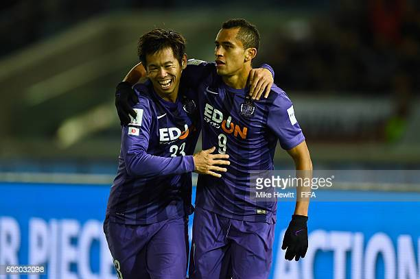 Douglas of Sanfrecce Hiroshima celebrates with team mate Tsukasa Shiotani after scoring the winning goal during the FIFA Club World Cup 3rd Place...