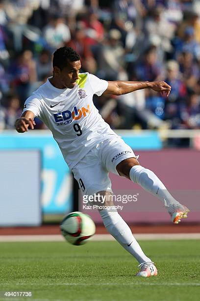 Douglas of Sanfrecce Hiroshima scores his team's first goal during the J.League match between Ventforet Kofu and Sanfrecce Hiroshima at Yamanashi...
