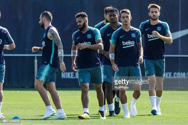 Douglas Pereira from Brasil Denis Surez from Spain Sergi Samper from Spain and Marlon Santos from Brasil during the first FC Barcelona training...