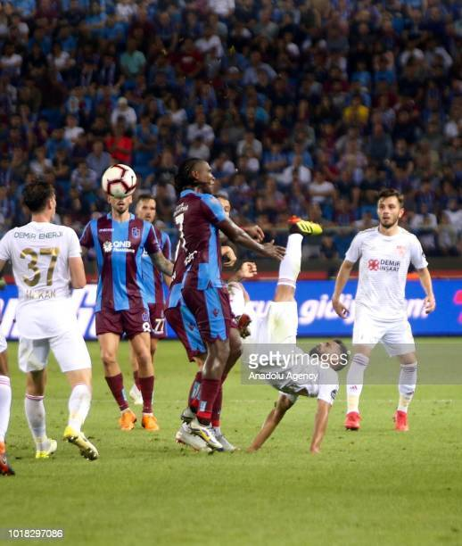 Douglas Pereira of Demir Grup Sivasspor in action against Hugo Rodallega and Olcay Sahan of Trabzonspor during the Turkish Super Lig soccer match...