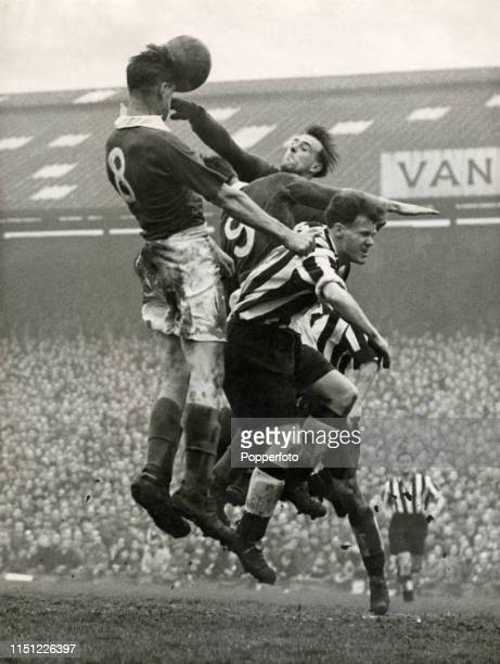 Douglas Reid of Portsmouth outjumping the Newcastle United defence during the FA Cup 6th round match at Fratton Park in Portsmouth on 8th March 1952....