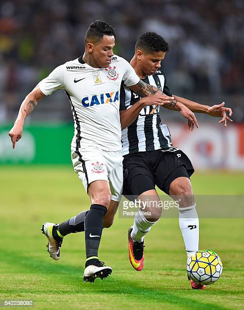 Douglas Santos of Atletico MG and Giovanni Augusto of Corinthians battle for the ball during a match between Atletico MG and Corinthians as part of...