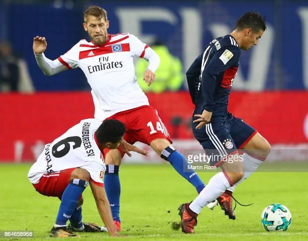 Douglas Santos of Hamburg and Aaron Hunt of Hamburg chase James Rodriguez of Bayern Muenchen during the Bundesliga match between Hamburger SV and FC...
