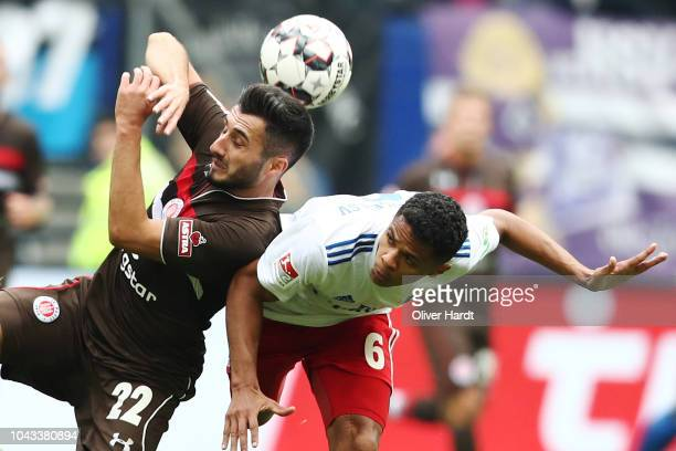 Douglas Santos of Hamburg and Cenk Sahin of Pauli compete for the ball during the Second Bundesliga match between Hamburger SV and FC St Pauli at...