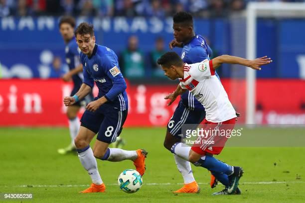 Douglas Santos of Hamburg fights for the ball with Breel Embolo of Schalke during the Bundesliga match between Hamburger SV and FC Schalke 04 at...