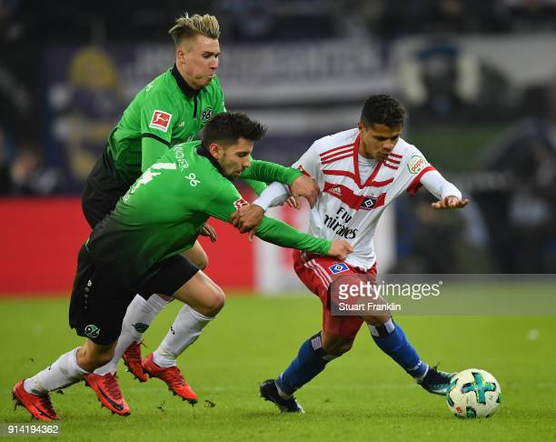 Douglas Santos of Hamburg is challenged by Julian Korb of Hannover during the Bundesliga match between Hamburger SV and Hannover 96 at...