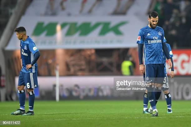 Douglas Santos of Hamburg Mergim Mavraj of Hamburg and Tatsuya Ito of Hamburg dejected after the Bundesliga match between FC Augsburg and Hamburger...