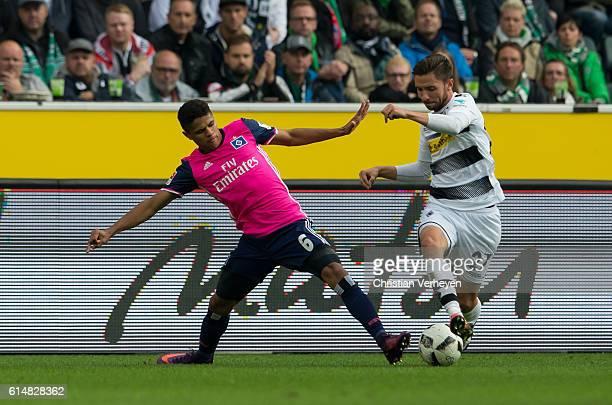 Douglas Santos of Hamburger SV and Julian Korb of Borussia Moenchengladbach battle for the ball during the Bundesliga match between Borussia...