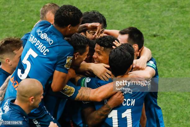 Douglas Santos of Zenit Saint Petersburg celebrates his goal with teammates during the Russian Premier League match between FC Zenit Saint Petersburg...