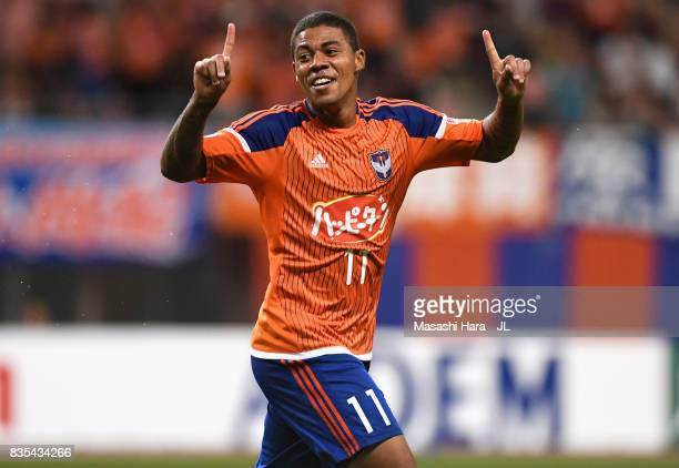 Douglas Tanque of Albirex Niigata celebrates scoring the opening goal during the JLeague J1 match between Albirex Niigata and Vegalta Sendai at Denka...
