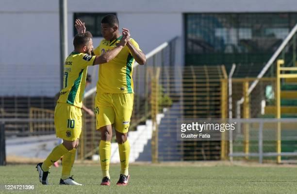 Douglas Tanque of FC Pacos de Ferreira celebrates with teammate Pedrinho of FC Pacos de Ferreira after scoring a goal during the Liga NOS match...