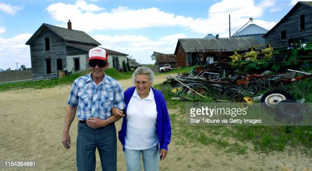 Douglas Twp Mn Thurs May 23 2002Donald Rohr and wife Shirley on their farm IN THIS PHOTO Don who is going blind and Shirley walk through what was...