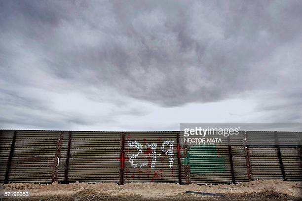 A sign is posted in a section of the wall that separates Mexico and the US referring to the number of death that perished crossing the border near...