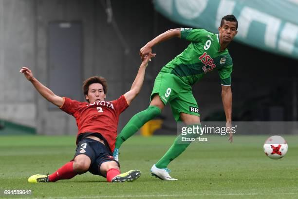 Douglas Vieira of Tokyo Verdy and Kazuki Kushibiki of Nagoya Grampus compete for the ball during the J.League J2 match between Tokyo Verdy and Nagoya...