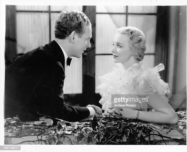 Douglas Walton leaning towards Virginia Bruce in a scene from the film 'The Garden Murder Case' 1936