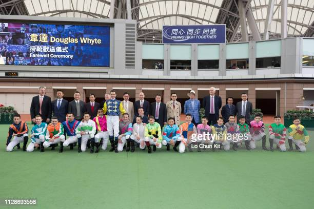 Douglas Whyte poses for a group photo with trainers and jockeys during the Farewell Ceremony at Sha Tin racecourse on February 10, 2019 in Hong Kong.