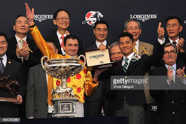 Douglas Whyte poses with trophy with Longines ambassador Aaron Kwok after winning Race 8 The Longines Hong Kong Cup during Hong Kong International...