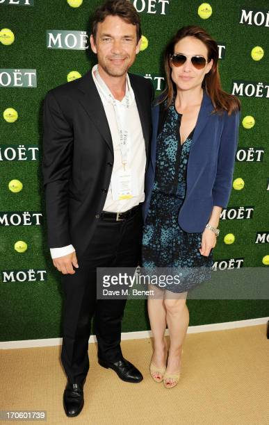Dougray Scott and Claire Forlani attend The Moet Chandon Suite at The Aegon Championships Queens Club SemiFinals on June 15 2013 in London England