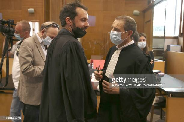 Douib family's lawyer Jean Sabastien de Casalta talks with defendant Bruno Garcia-Cruciani's lawyer Camille Radot before the start of the trial of...