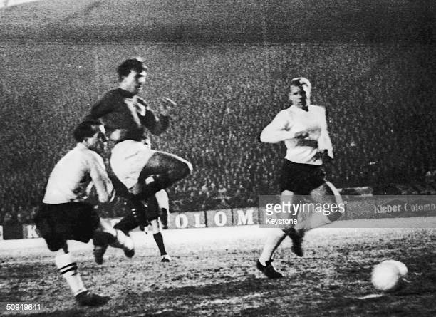 Douis, the French inside forward scores France's second goal against England in the European Nations Cup in Paris, 27th February 1963. Also pictured...