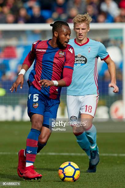Doukoure of Levante UD competes for the ball with Daniel Wass of Real Club Celta de Vigo during the La Liga game between Levante UD and Real Club...
