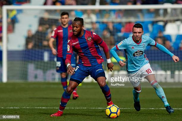 Doukoure of Levante UD competes for the ball with Iago Aspas of Real Club Celta de Vigo during the La Liga game between Levante UD and Real Club...