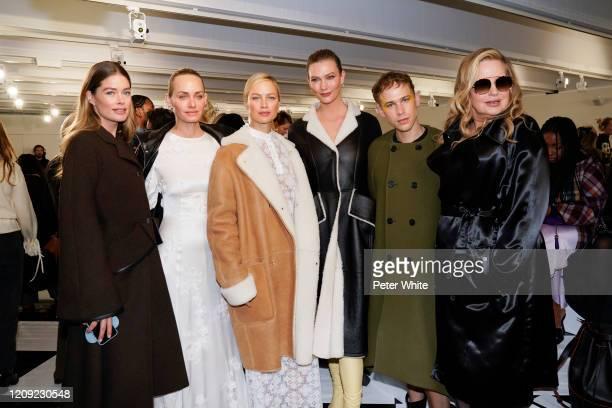 Doutzen Kroes, Amber Valletta, Carolyn Murphy, Karlie Kloss, Tommy Dorfman and Jennifer Coolidge attend the Loewe show as part of the Paris Fashion...