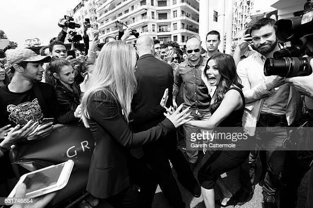 Doutzen Kroes and Eva Longoria meet with fans outside the Martinez Hotel during the 69th annual Cannes Film Festival on May 11 2016 in Cannes France