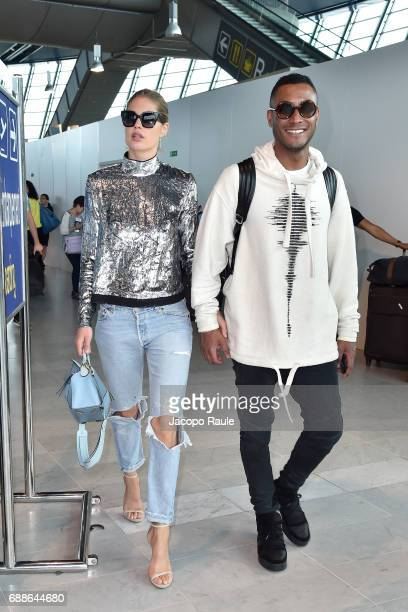 Doutzen Kroes and Sunnery James arrive at Nice airport during the 70th annual Cannes Film Festival at on May 26 2017 in Cannes France