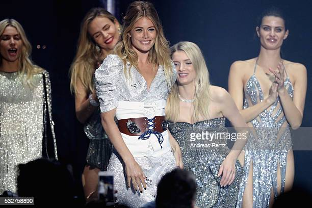 Doutzen Kroes appears on stage at the amfAR's 23rd Cinema Against AIDS Gala at Hotel du CapEdenRoc on May 19 2016 in Cap d'Antibes France