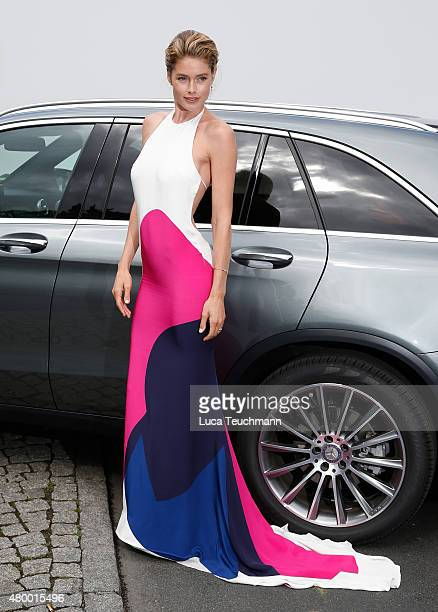 Doutzen Kroes attends the MercedesBenz Press Vernissage during the MercedesBenz Fashion Week Berlin Spring/Summer 2016 at Brandenburg Gate on July 9...