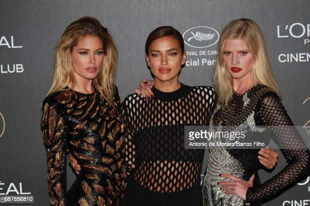 Doutzen Kroes Irina Shayk and Lara Stone attend the Gala 20th Birthday Of L'Oreal In Cannes during the 70th annual Cannes Film Festival at Hotel...