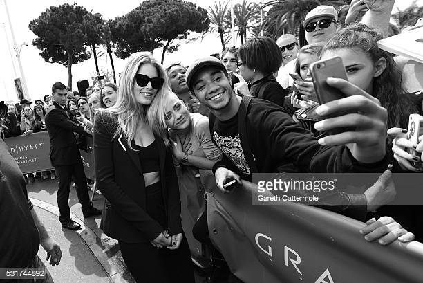 Doutzen Kroes meets with fans outside the Martinez Hotel during the 69th annual Cannes Film Festival on May 11 2016 in Cannes France